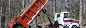 Dump truck with telescopic hydraulic cylinders